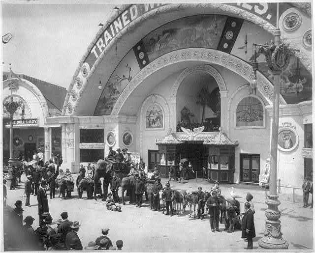 World's Columbian Exposition, Chicago, Ill.: trained animals lined up, with trainers, clowns and others
