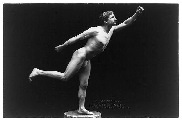 [Nude male, Prof. B.A. McFadden, full-length portrait, standing on one foot on pedestal, facing right, wearing a fig leaf]