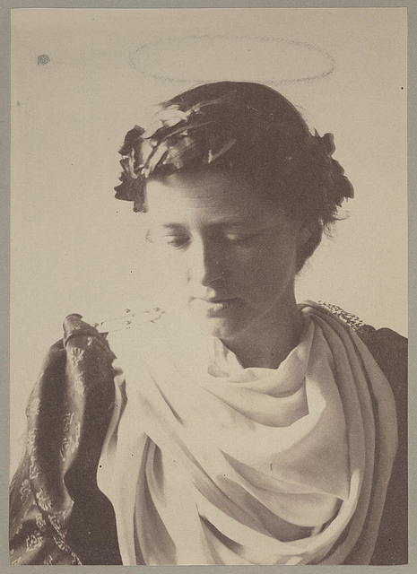 [Woman (Louise Guiney) in Saint Barbara costume with laurel wreath and (penciled in) halo]