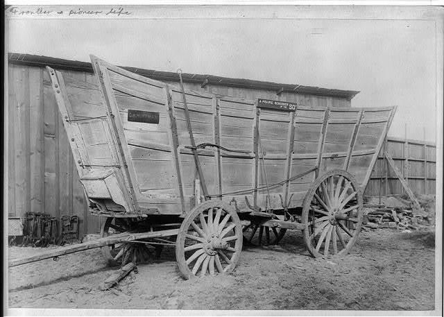 A prairie schooner of the 50's at '49 mining camp. California Midwinter International Exposition
