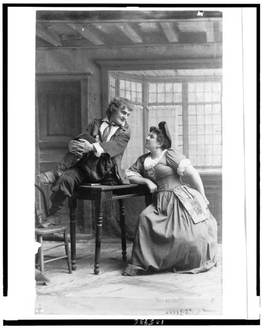 [Joseph Jefferson, full-length portrait, seated on table, facing right, looking at a woman]