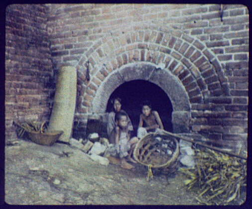 Family living in an arch under the Great Wall
