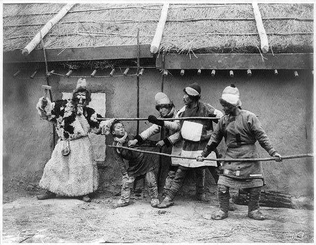 """Goldi tribesmen acting out folk drama, """"The repulse of the kidnapper"""""""