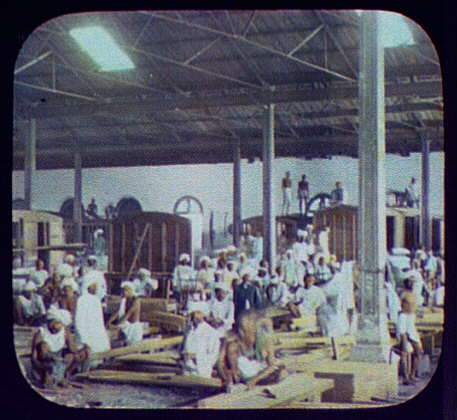 Indian workers constructing railway coaches