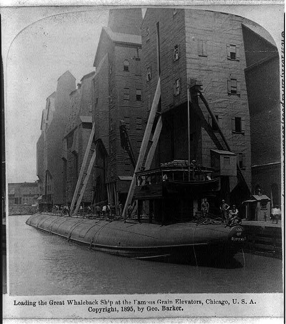 Loading the great whaleback ship at the famous grain elevators, Chicago, U.S.A.