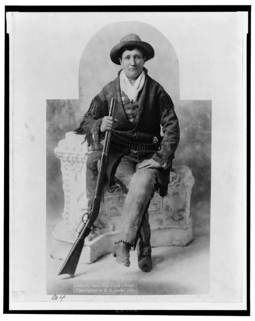 "[Martha Canary, 1852-1903, (""Calamity Jane""), full-length portrait, seated with rifle as General Crook's scout]"