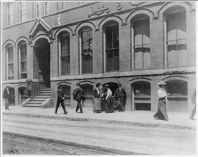 [Massachusetts. Lynn. shoe factories, 1895?: sidewalk scene outside Luddy Co.]