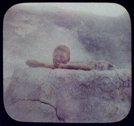 "Pete in the ""Brown Pot"" - Maori boy inside small geyser"