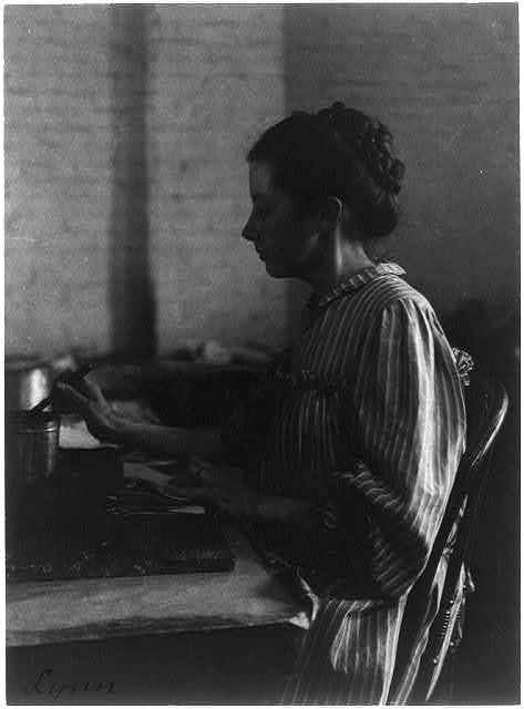 [Shoe factories, Lynn, Mass.: woman seated at table, working in shoe factory]