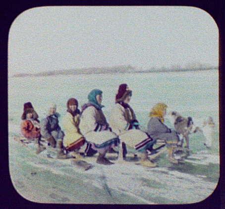 Six Goldi women and children on dog sledge