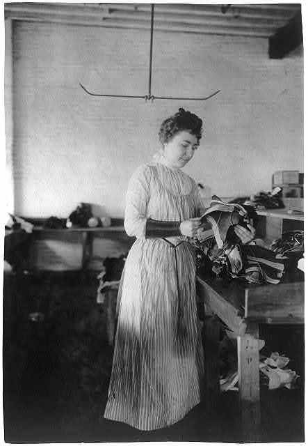 [Woman distributing work in a shoe factory, Lynn, Mass.]