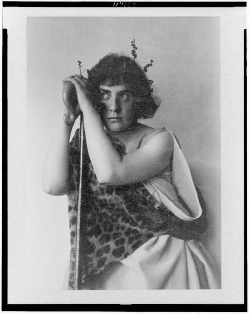 [Woman (Ethel Reed) in nymph costume as Chloe with leopard skin, berry branches in hair, and shepherd's crook]