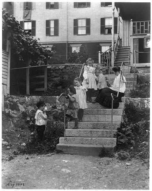 [Woman on steps with 5 children, Lynn, Mass.]