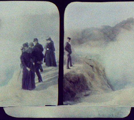 WTC [i.e. World Transportation Commission] members and women at edge of crater geyser