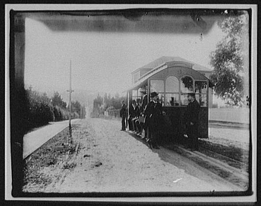 WTC [i.e. World Transportation Commission] members on street-car on dirt road in country - Dunedin