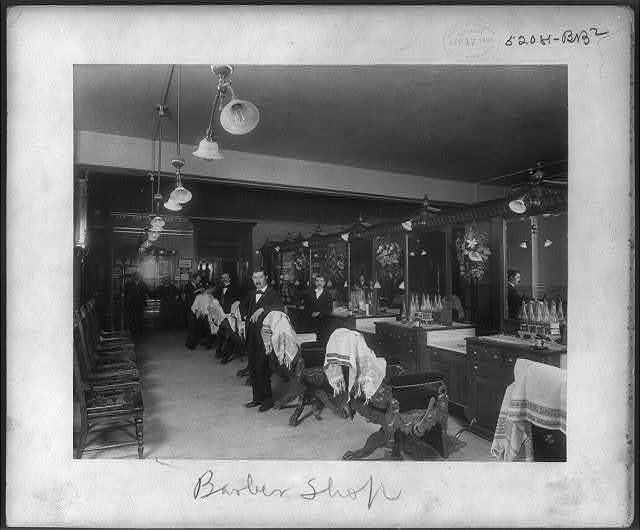 [7 men in a barber shop, Philadelphia, Pa.]