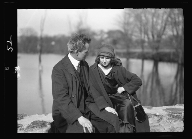 Arnold Genthe seated outdoors with a woman friend