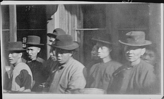 Group of men standing on a street, Chinatown, San Francisco