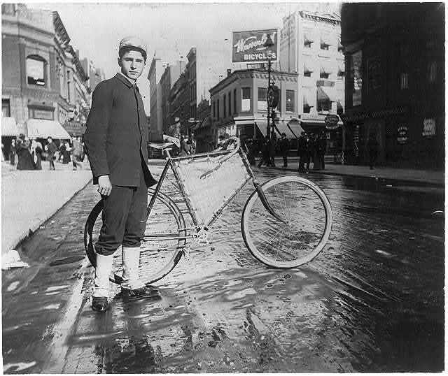 [Street types of New York City: Messenger boy and bike]