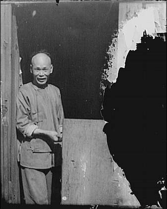 The Chinese cook, grinning from the doorway, Chinatown, San Francisco