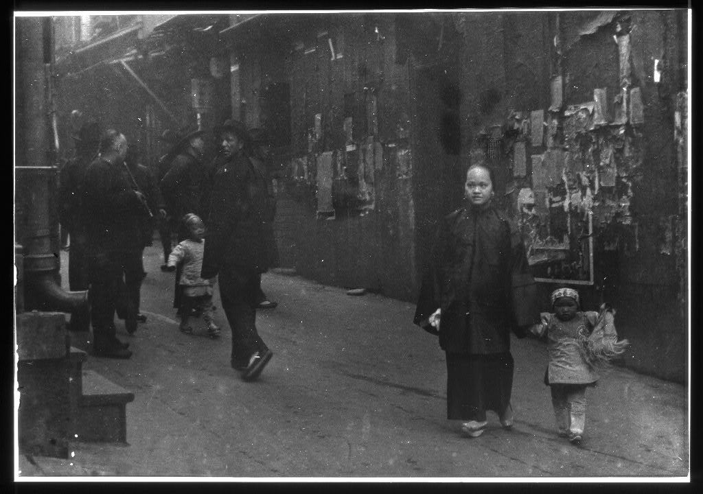 Woman and a child walking down a street, Chinatown, San Francisco