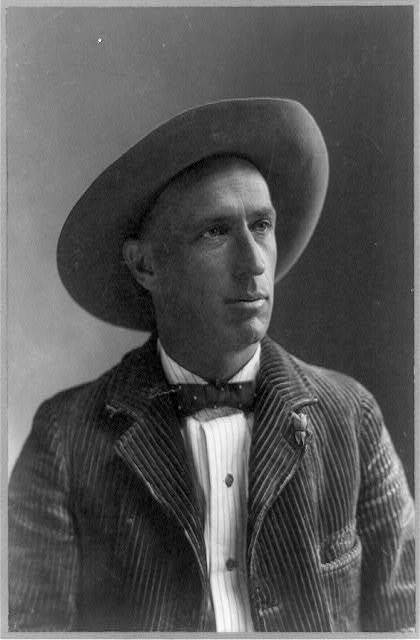 [Charles Fletcher Lummis, half-length portrait, facing right, wearing wide-brimmed hat]
