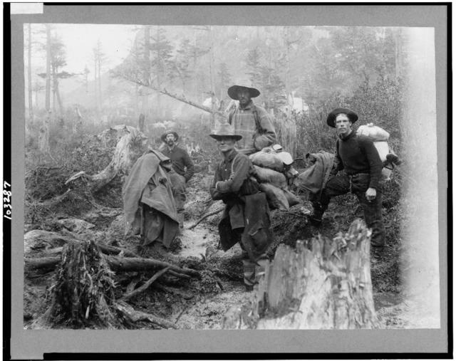 [Four prospectors posed on trail, Alaska]