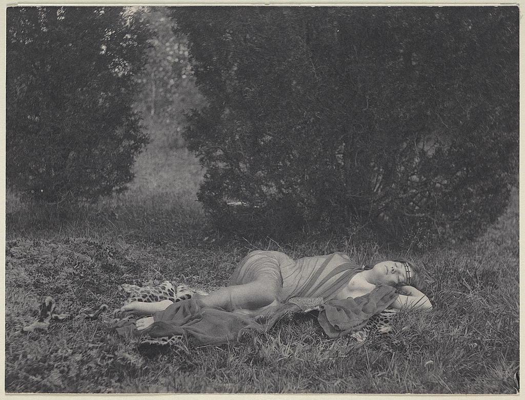 [Girl in sheer drapery on leopard skin, in nature, reclining]