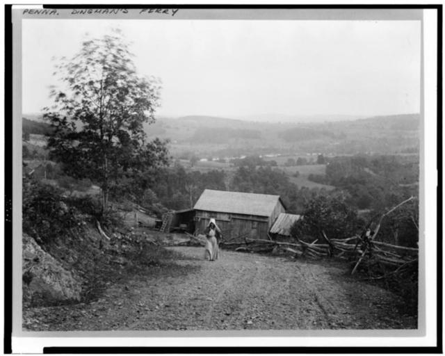 [Landscape with woman walking up hill, barn below, and rail fence along road, at twilight, Dingman's Ferry, Pennsylvania]