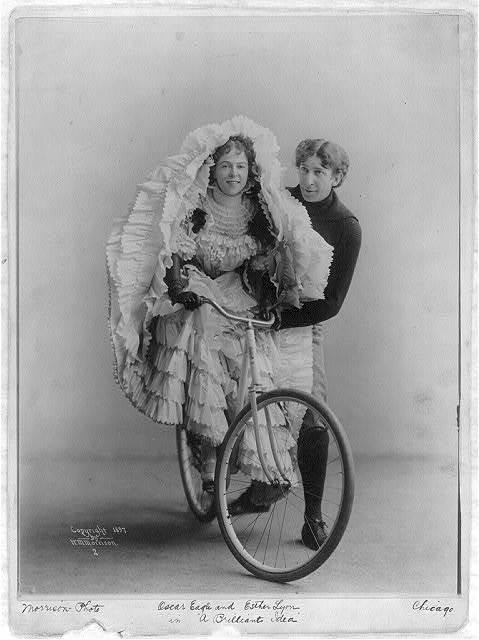 "Oscar Eagle standing alongside of Esther Lyon (on bicycle), in ""A Briliant Idea"""