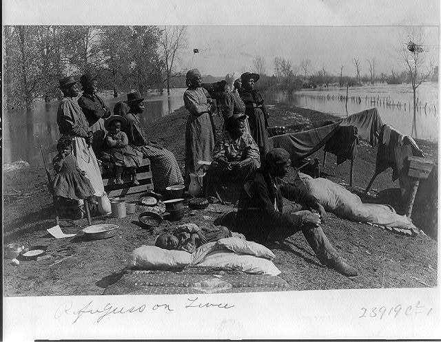 Refugees on levee, April 17, 1897 / photo by Carroll's Art Gallery.