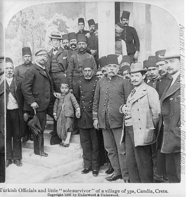 "Turkish officials and little ""sole survivor"" of a village of 350, Candia, Crete"