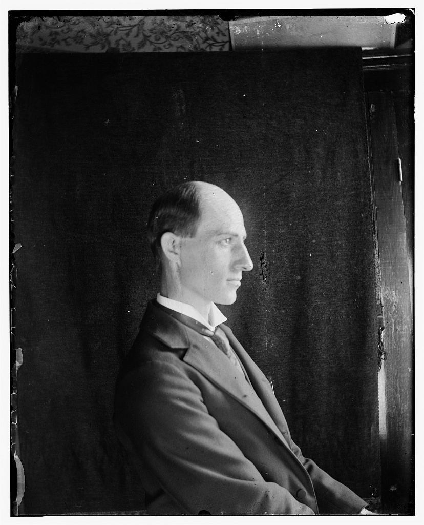 Wilbur Wright, age 30, seated facing right, half-length side