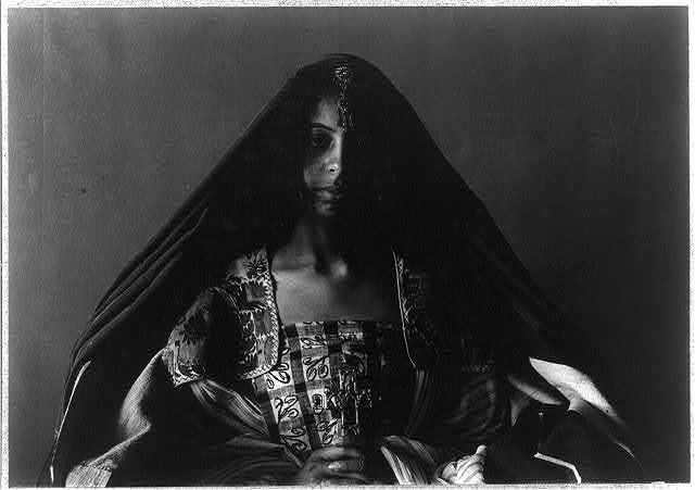 [Young woman (Angela Grimké) in Middle Eastern costume and Tuareg tribe headdress, half-length portrait, seated, facing front]