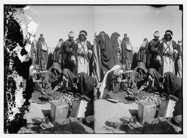 Arab women bartering at market