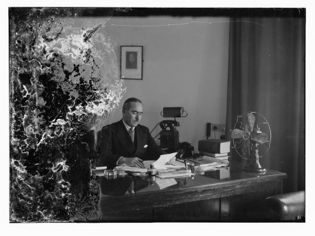 Barclay's Mr. Clarks, Director, at his desk