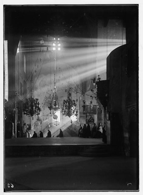 Bethlehem. Church of the Nativity. (Dark interior lit by sun rays)