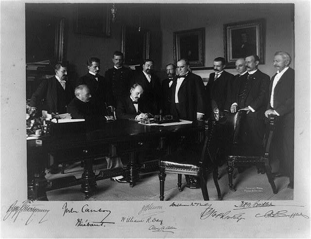 Cabinet Room, White House, Aug. 12, 1898. Secy. of State William R. Day signing