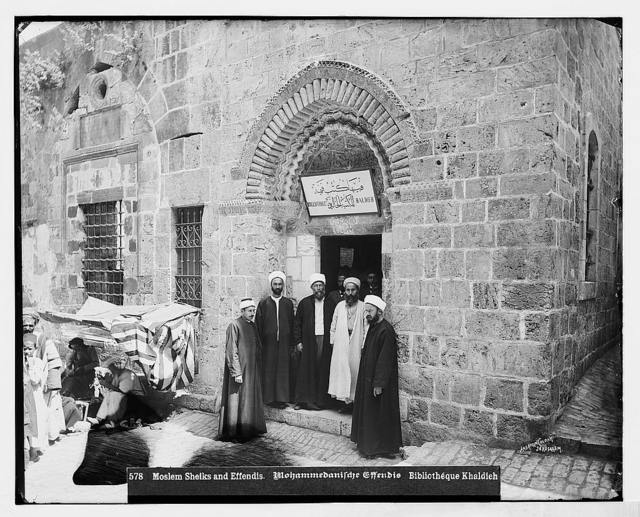 Costumes and characters, etc. Mohammedan [i.e., Muslim] sheikhs and effendies in front of Bibboth Khaldieh [i.e., Khalidiyah Library], Jerusalem