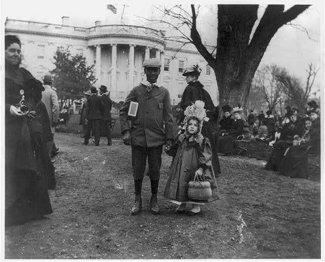 [D.C. Wash. - White House - Negro boy holding hand of small white girl during Easter egg roll]