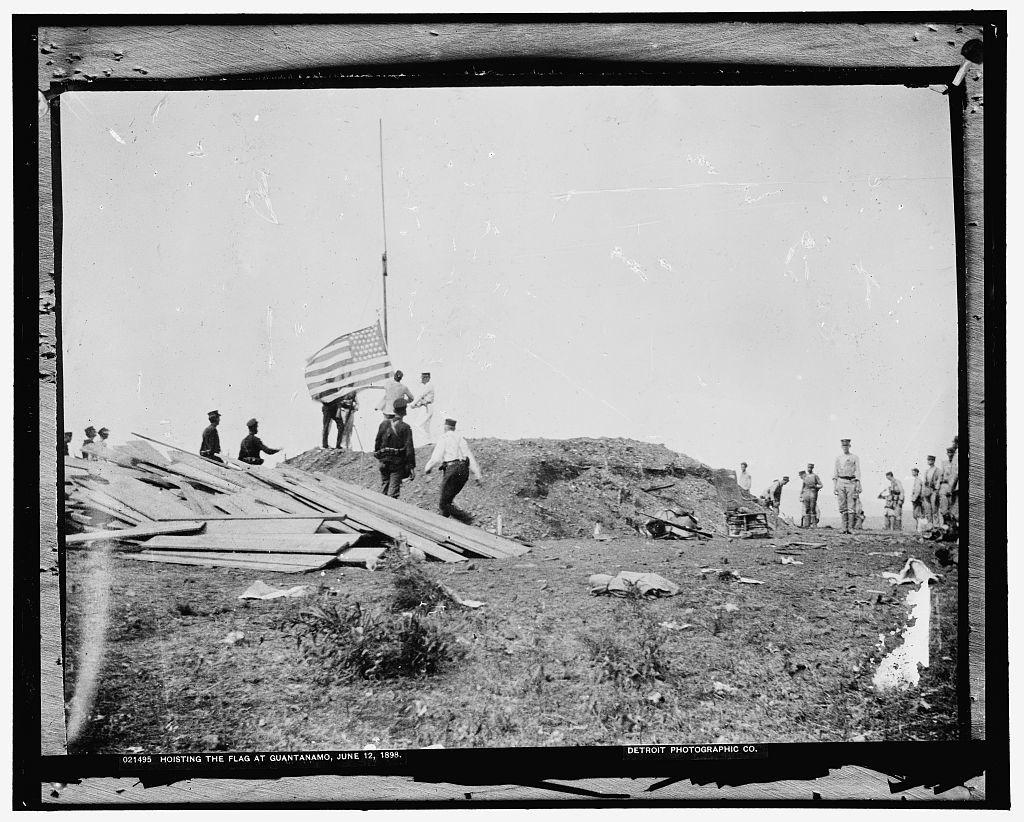 Hoisting the flag at Guantanamo, June 12, 1898