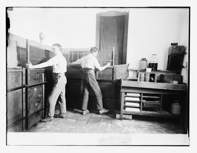 Lewis Larsen [i.e., Larsson] developing film at A.C. [i.e., American Colony] photo dept