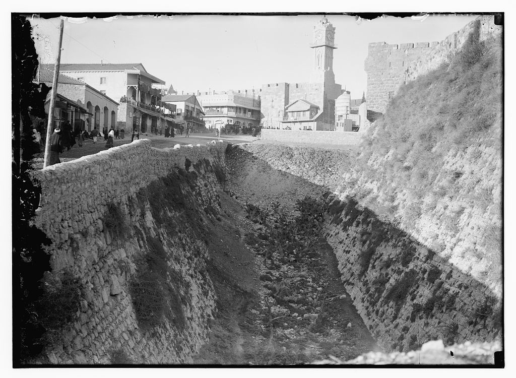 Looking down moat outside Tower of David toward clock tower, before 1917 / American Colony, Jerusalem