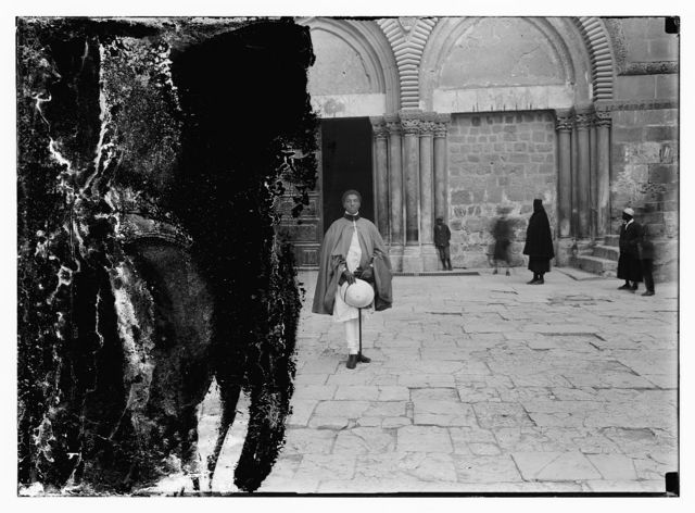 Member of Abyssinian Crown Prince group outside of the entrance to the Church of the Holy Sepulchre