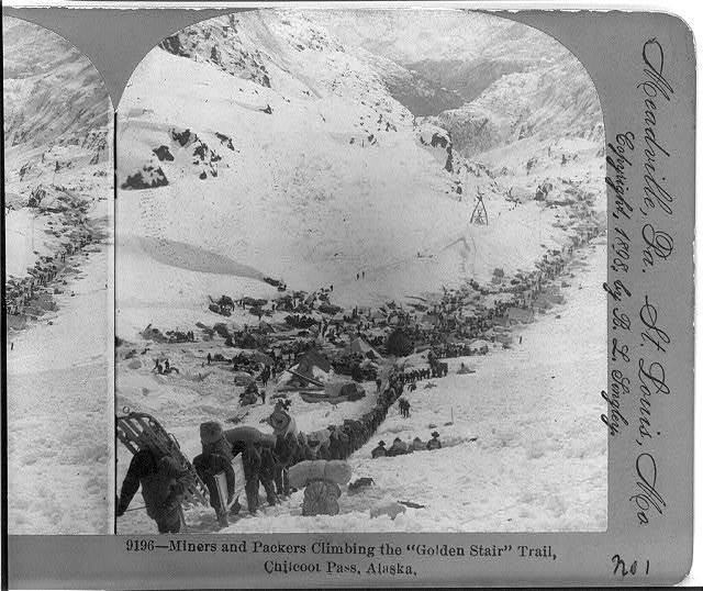 "Miners and packers climbing the ""Golden Stair"" trail, Chilcoot Pass, Alaska"