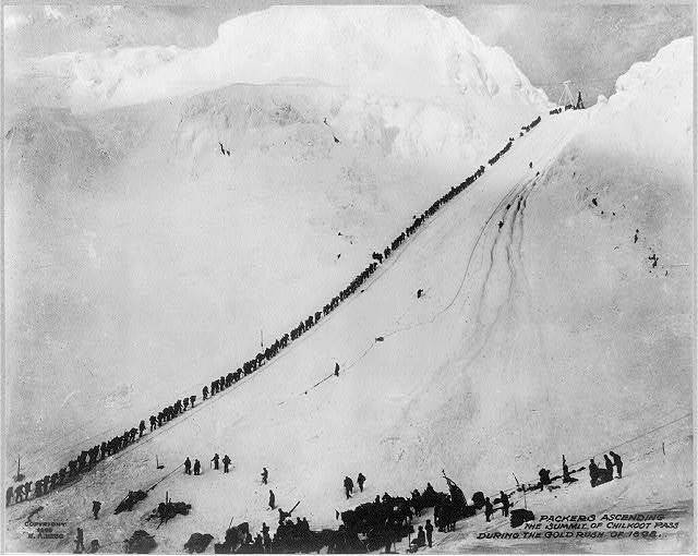 Packers ascending the summit of Chilkoot Pass during the gold rush of 1898