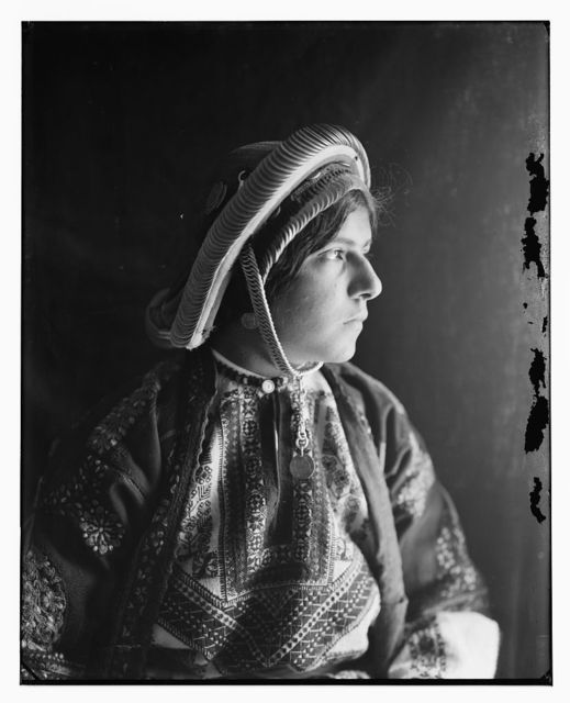 Peasant girl from Ramallah district with dowry coin headdress