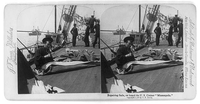 Repairing sails aboard Cruiser USS MINNEAPOLIS