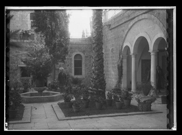 Small girl in courtyard