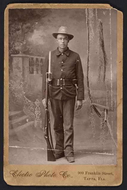 [Spanish American War, Infantry, holding Krag rifle with fixed bayonette, cartridge belt] / Electro Photo Co., 909 Franklin Street, Tampa, Fla.